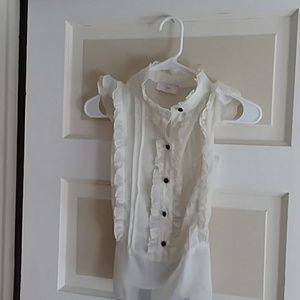 Aqua ivory ruffled blouse with black buttons.